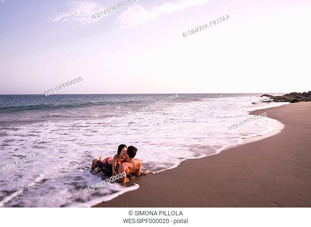 Couple in love kissing in the sea