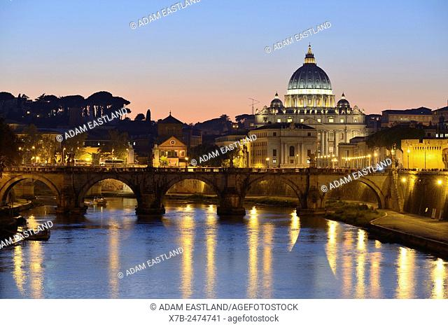 Rome. Italy. View of St Peter's Basilica, the river Tiber & Ponte Sant' Angelo
