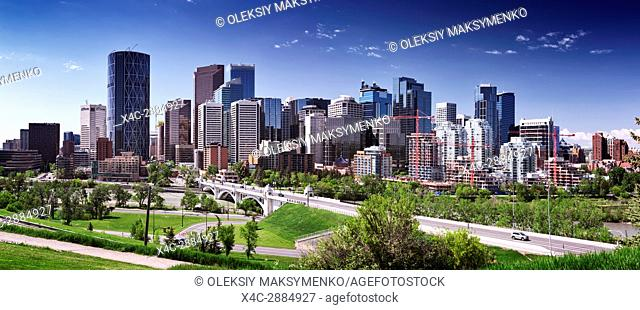 Calgary city downtown beautiful skyline panoramic view with Centre Street Bridge over Bow river, summer day urban scenery