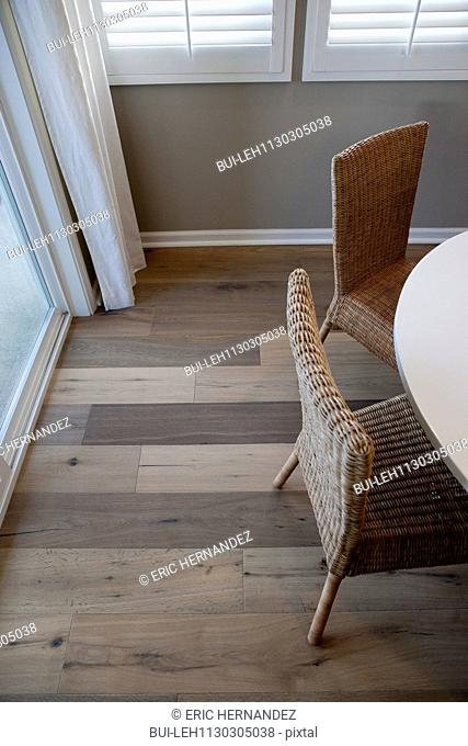 High angle view wicker chairs at dining table