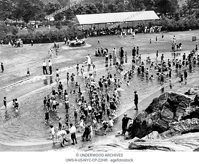 New York, New York: c. 1927 The playground in Central Park has had an impromptu kiddie pool added to provide relief from the sweltering heat