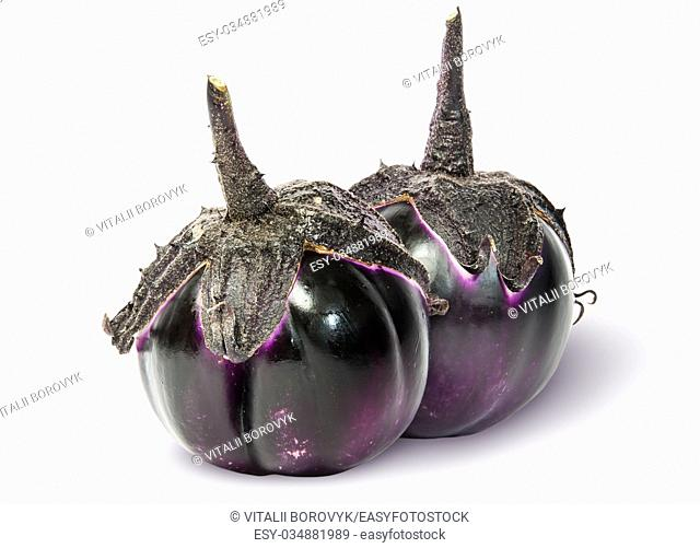 Two ripe round eggplant vertically isolated on white background