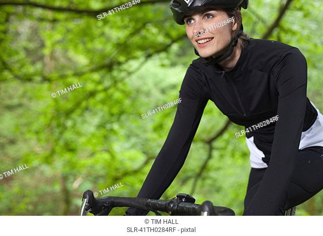 Cyclist biking in park