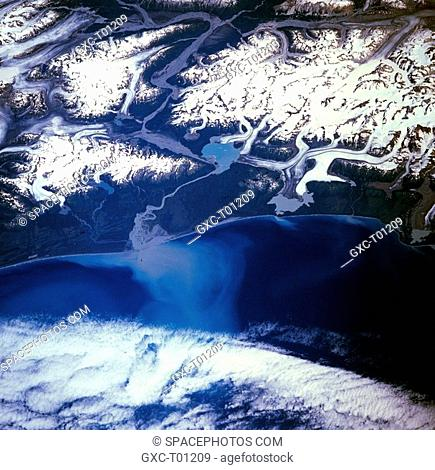 The northwest-southeast-oriented Saint Elias Mountains appear slightly inland from the coast and are the major landform in this photograph