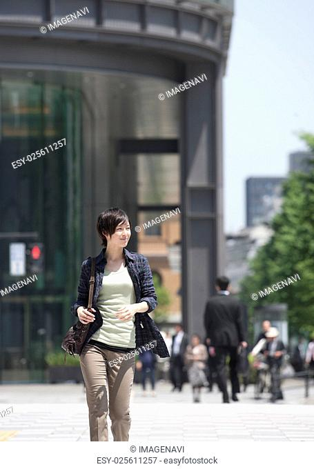 Young woman in street
