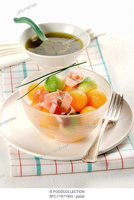 Avocado and salad with strips of ham
