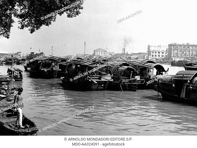 Sampan boats and houses. Sampan boats also used as dwellings docked on the Pearl River. Canton, 1950s