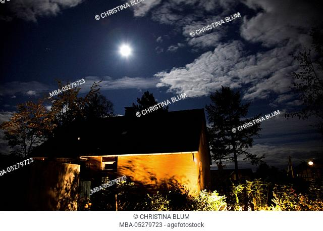 Moonlight and garden lighting at a house