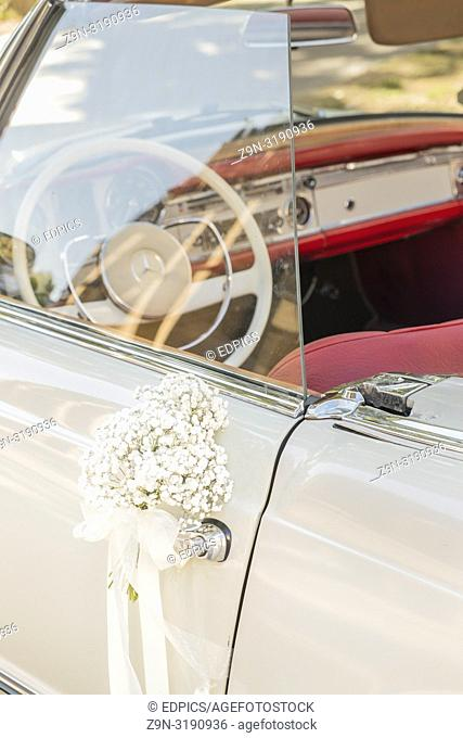 vintage mercedes with bride's bouquet attached to the door, stuttgart, baden-wuerttemberg, germany