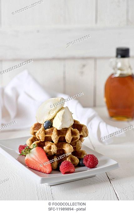 Waffles with mascarpone, berries and maple syrup