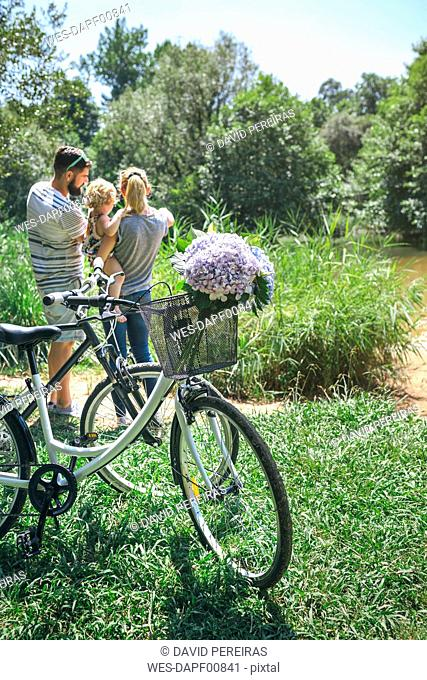 Family with bicycle in the countryside