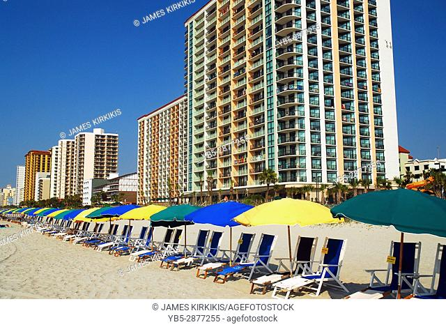 Beach Chairs and Umbrellas Await the Sun Seekers at Myrtle Beach