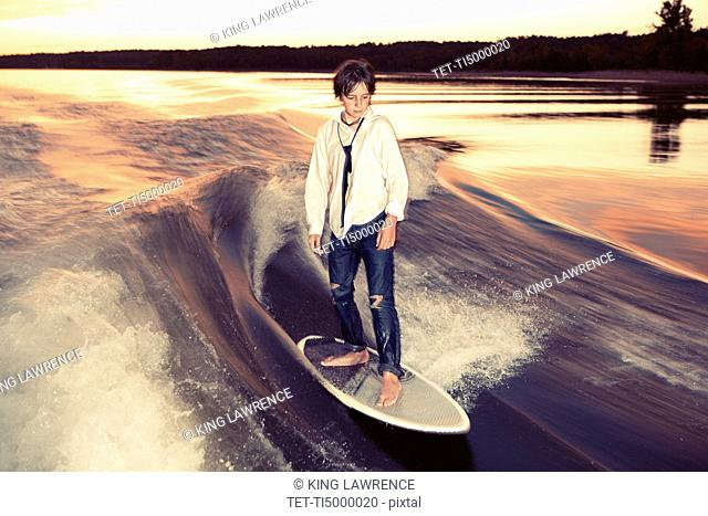 Boy wakeboarding on Lake Greeson