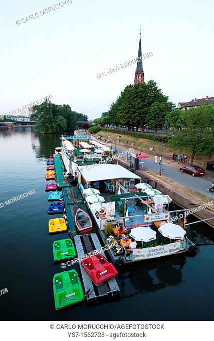 The Frankfurt am Main skyline and boat restaurants moored on the Main river, seen from Alte brücke bridge, Germany, Europe