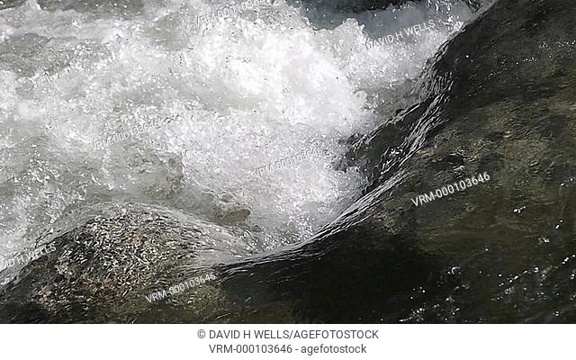 Close-up of water passing over rapids at waterfall in Yosemite, California