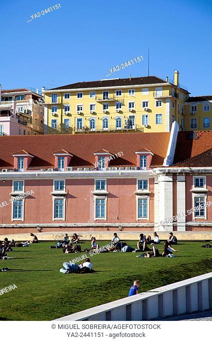 People Relaxing on Grass Embankment at Doca da Caldeira in Lisbon - Portugal
