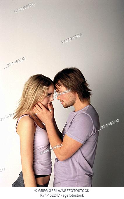 image of young couple embracing