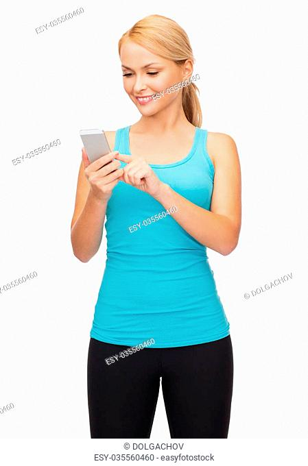 sport, exercise, technology, internet and healthcare - sporty woman with smartphone