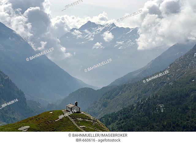 Gran Paradiso National Park between Piemonte Piedmont and Aosta valley Italy Garian Alps church chiesa Madonna della Neve at the Lago di Serru Lake Serru Valle...