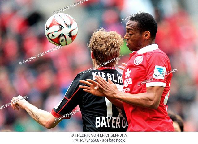 Mainz's Junior Diaz (r) and Leverkusen's Stefan Kiessling (l) compete for the ball during the German Bundesliga soccer match between FSV Mainz and Bayer...