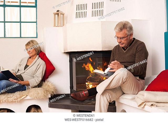 Germany, Kratzeburg, Senior couple reading book