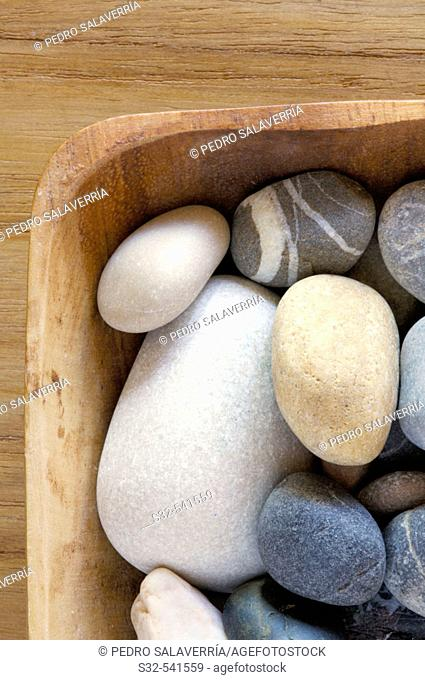 Wooden bowl filled with stones
