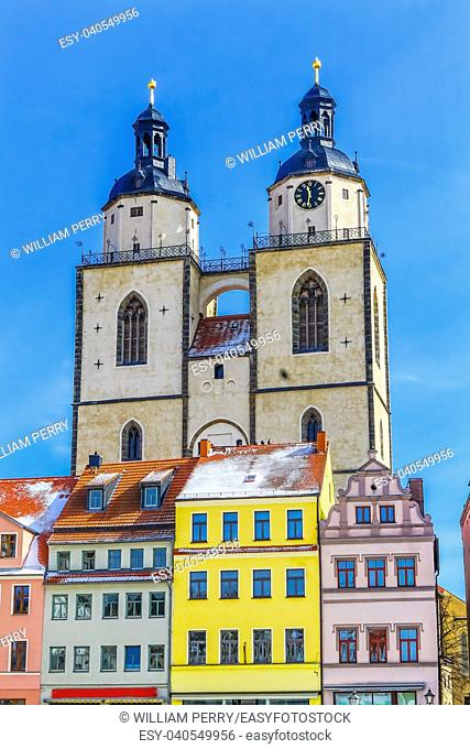 Colorful Market Square Saint Mary's City Church Stadtkirche Lutherstadt Wittenberg Germany. Martin Luther's church. Founded in 1187, restored in 1900s