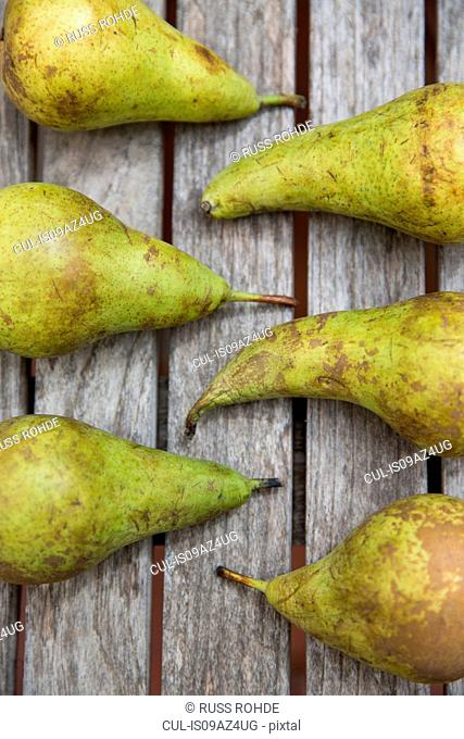 Overhead view of six pears on table