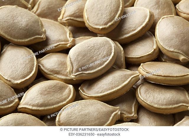 Dried pumpkin seeds close up full frame