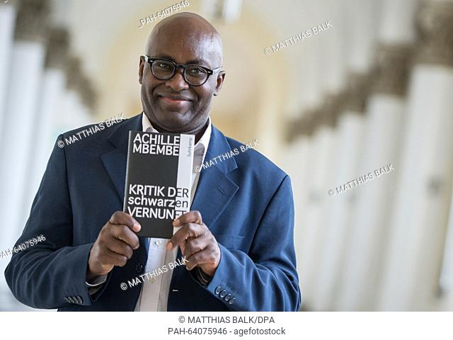 Author Achille Mbembe poses at Ludwig Maximilian University in Munich, Germany, 30 November 2015. Mbembe was awarded this year's Geschwister Scholl Prize for...