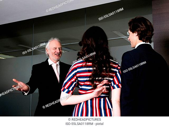 Business executive crossing her fingers behind her back on being welcomed in meeting room