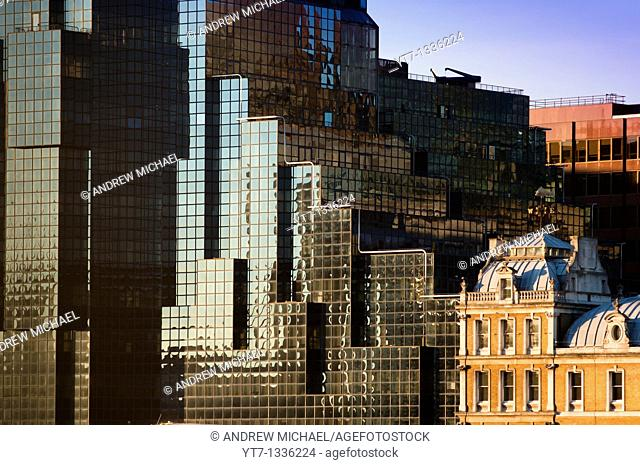Abstract image of contrasting modern and old architecture on banks of the river Thames, London