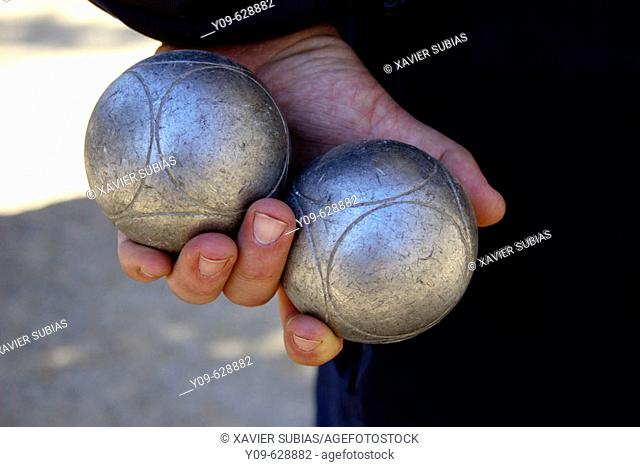 Hand with petanque balls