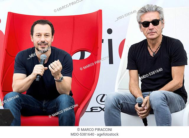 The actor Stefano Accorsi and the singer-songwriter Luciano Ligabue chatting at the event Fuoricinema. Milan, Italy. 18th September 2016