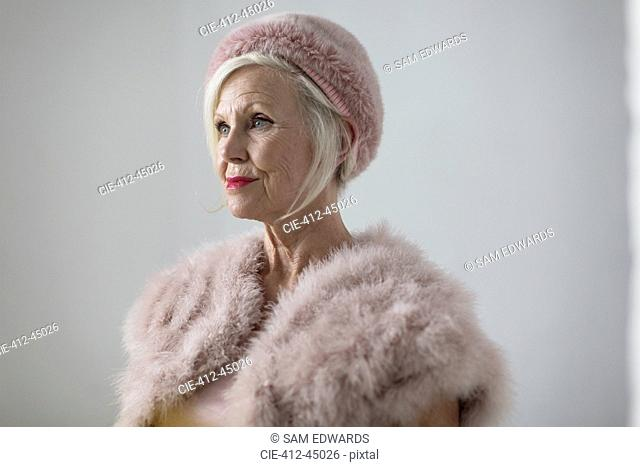 Portrait elegant senior woman wearing fur