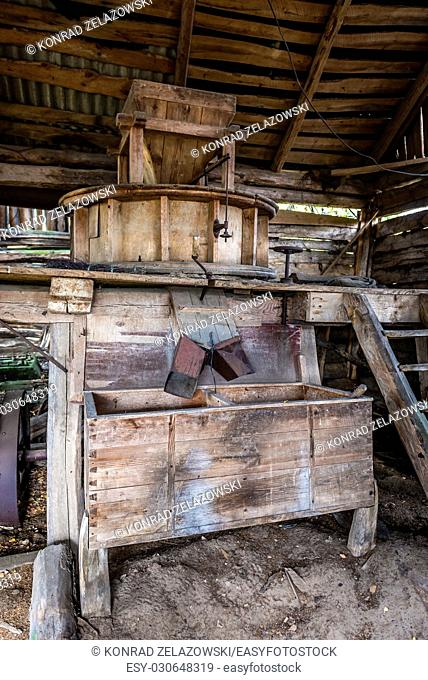 Old threshing machine in Mashevo abandoned village of Chernobyl Nuclear Power Plant Zone of Alienation area around nuclear reactor disaster in Ukraine
