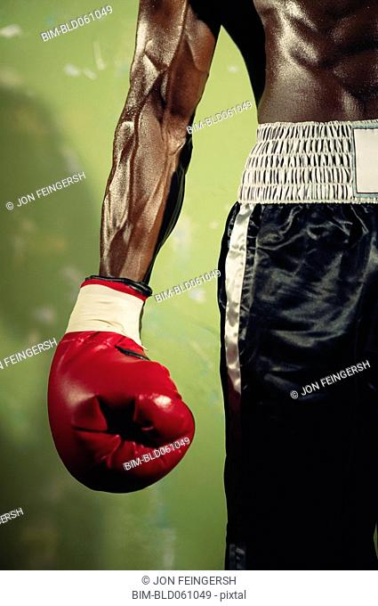 Close up of African male boxer's arm