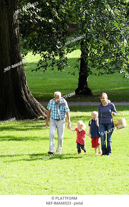 Senior man woman and children going for a picnic Sweden