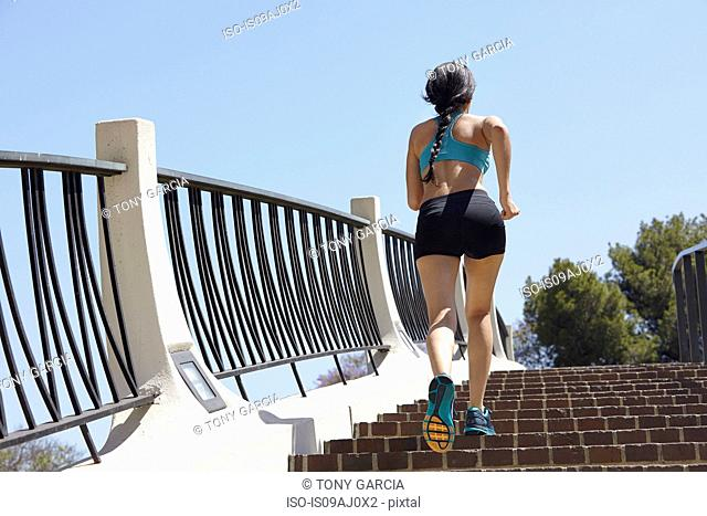 Jogger running up stairs