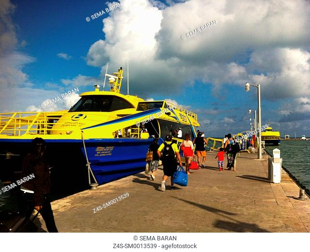 Tourists walking to the ferry at Isla Mujeres, Cancun, Quintana Roo, Yucatan Province, Mexico, Central America