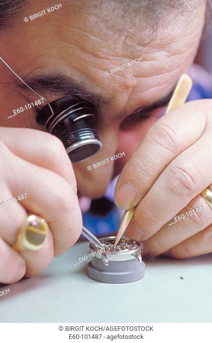 Watchmaker working on clockwork
