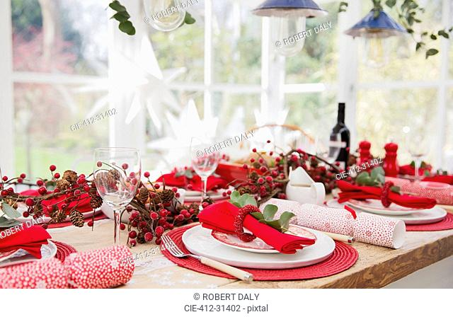 Placesettings and Christmas decorations on dining table