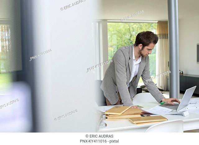 Interior designer working on a laptop in the office