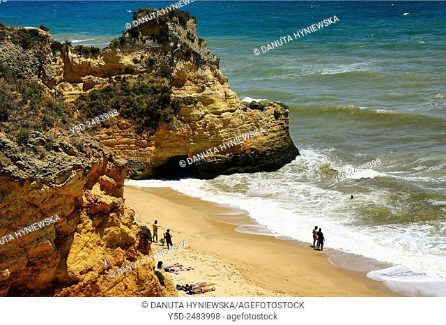 Europe, Portugal, Algarve, Western Algarve, Faro district, Lagos, people resting at Pinhao beach