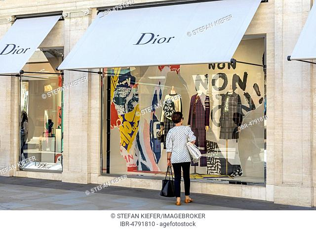 Passer-by in front of shop window, fashion shop Dior, London, United Kingdom