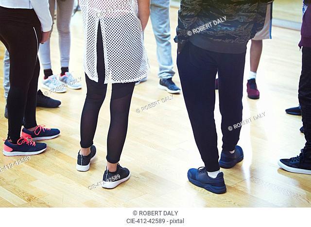 Teenage students standing in circle in dance class studio