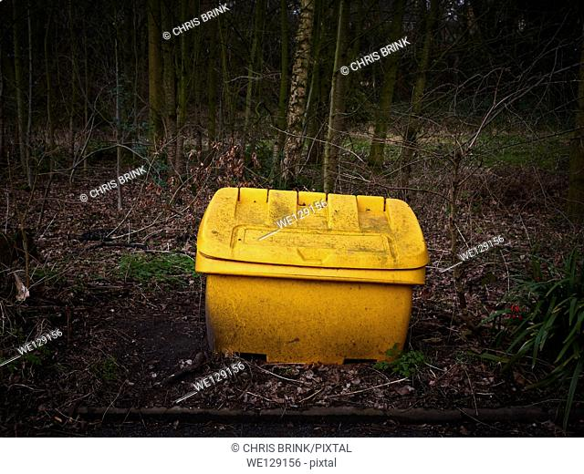 Yellow salt and sand box on the side of a road for health and safety reasons in Cheshire, England, UK, Europe
