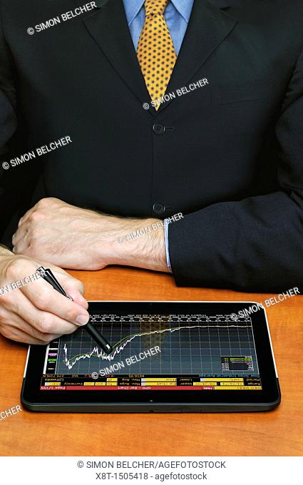 Businessman Using a Digital Tablet Computer to Check Stock Market Prices