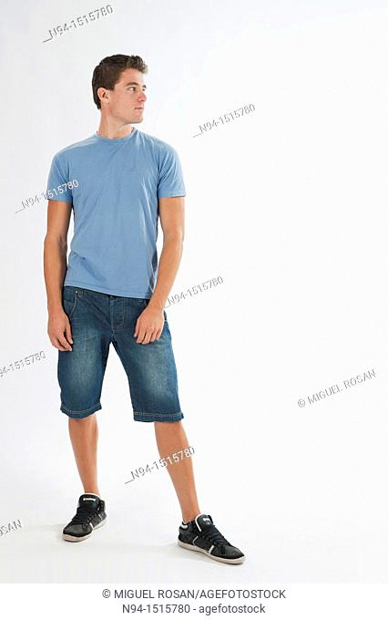 Full-body photograph of a teenage boy standing