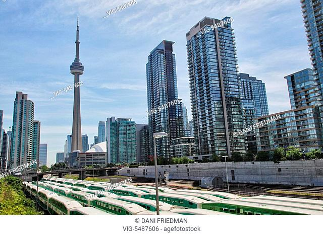 The CN Tower amongst skyscrapers and condominium buildings in Toronto, Ontario, Canada. The CN Tower measures 553.33 meters high (1,815